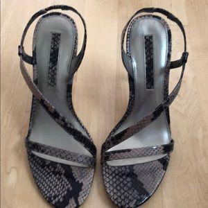 Women's size 7 snake skin heel.